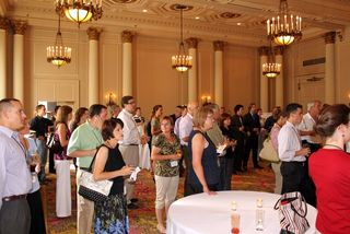 Attendees pause during the opening reception to hear a brief welcome from our hosts in Ottawa